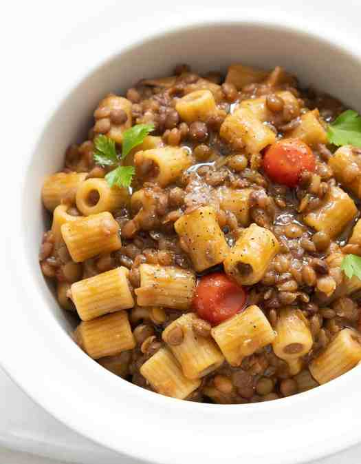 Vegan ditalini pasta and lentils in a white bowl - The Clever Meal