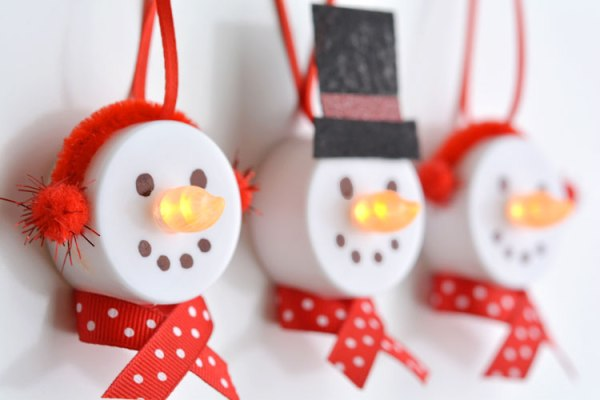 """These tea light snowman ornaments are really easy to make and they look ADORABLE! Turn on the tea light and the """"flame"""" becomes the snowman"""