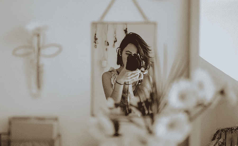 Lady photographing herself in the mirror - How Custom Virtual Tours Can Save Your Real Estate Business in 2020