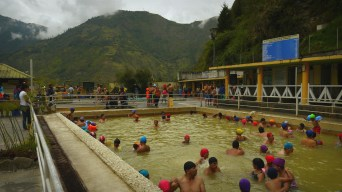 The hot spring pools with the mountains in the distance.