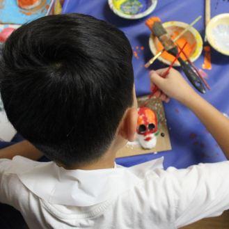 Club kid creating a sugar skull
