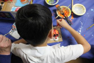Club kid creating a sugar skull