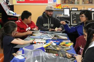 Brendan Walsh, Teen Director, and Jill Higa, SSF Area Director, lead members in a vision board project.
