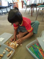 playing with wooden blocks in the library