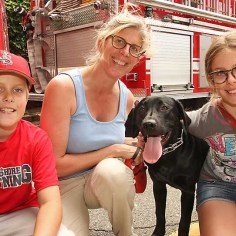 Sue, Sadie & Daniel Moran w/Champ, Neptune - He's the kid's first puppy. He's a six month old black lab. He's from Vermont.