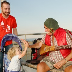 Douglas Berry of Asbury Park playing on the city boardwalk. With him are Matthew and Phineas Crouch, Howell Township.