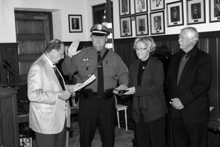 Above - Brian Egan is promoted and pictured with Mayor Morris Ades (left) and Egan's parents, Susan and Michael Egan.