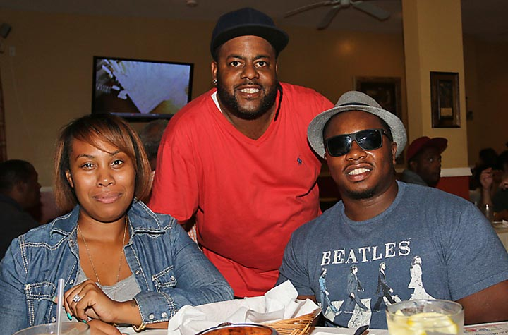 Hassan Scott (center) of At the Table in Asbury Park is pictured with customers Hatasha and Daryl Dixson, Neptune.