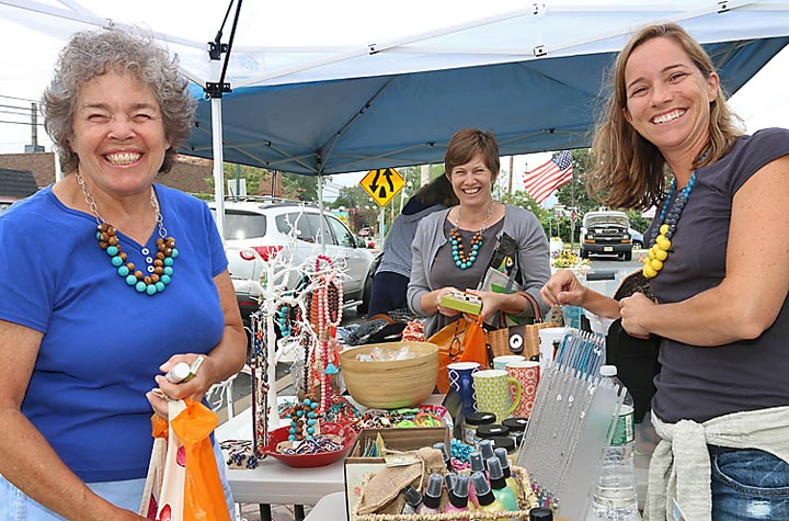 Shopping at the sidewalk sale at Bungalow Road in Avon were Mari McDevitt and Kelly McDevitt Connors, both of Avon. Waiting on them was Katie Cashman of Bungalow Road.