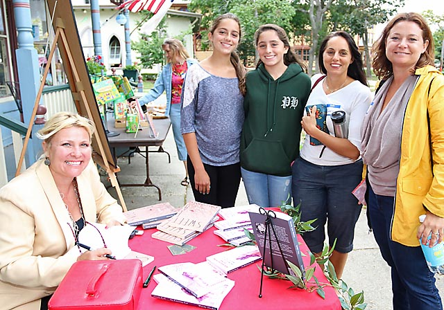 Signing copies of her book at The Hub in Ocean Grove was author Wendy Lynn Decker pictured with Emma, Audrey and Danene Wilenta and Danielle Coyle, all of Wall Township.