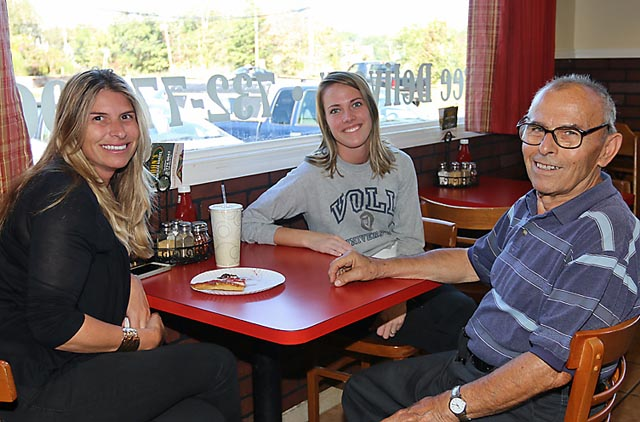 Evangelia Scheidt of John's Cracker Barrel in the Shark River Hills section of Neptune chats with Kassidy Voll and Chris Cosmas at the business.