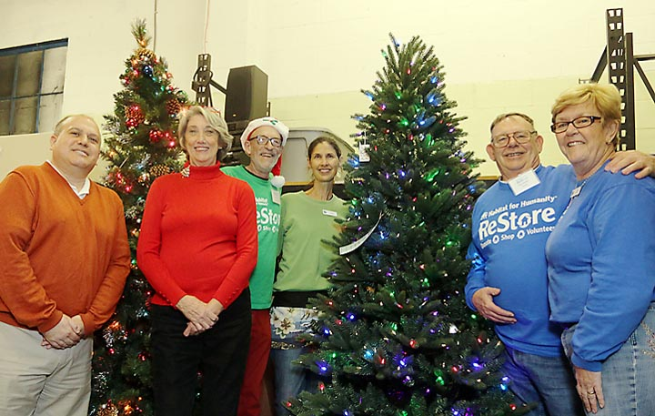Getting ready for the holidays at Restore thrift store in Asbury Park were Chris Hammer, Lynn Berkman, Andy Pawlan, Anne Cloutier and Norman and Sally Harris.