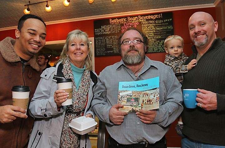 """At a book signing at the Barbaric Bean in Ocean Grove were Isaac Echevarri, Bronx; Kathy Poehnert, Ocean Grove; Chris Flynn, author of """"Ocean Grove, New Jersey"""" and Jeff Lewis of Ocean Grove with James."""