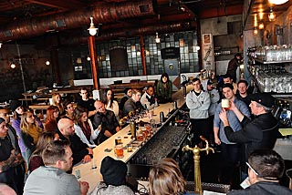 Brian Panzika of Pilsner Urguell (right) instructs the staff at Asbury Festhalle and Biergarten in Asbury Park on the proper way to serve beer. Coaster photo.
