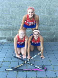 The captains of the Ocean Township High School field hockey team are Erin Tanasy (rear), Morgan Hendley (left) and Samantha Thurman. Photo credit: Danielle Reichardt