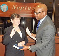 Coaster Photo - Neptune's new Township Committeewoman Carol J. Rizzo was sworn in by Mayor Kevin McMillan at this week's meeting.