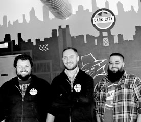 Coaster Photo - At the Dark City Brewing Company are Stephen Bohacik, founder Kevin Sharpe and Jaret Gelb.