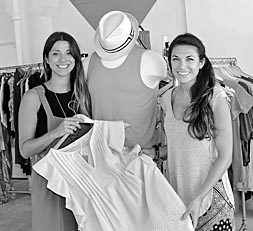 Coaster Photo - Ashely Casatelli and Maggie Messina display some of the items for sale at Storehouse on the boardwalk in Asbury Park.