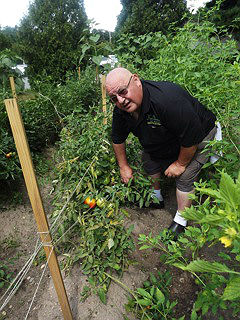 Coaster Photo - Chef Louie Dello in his garden at Luigi's Tavern in Tinton Falls.