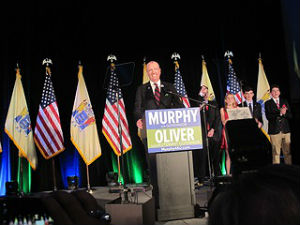 Coaster Photo - Phil Murphy with his family behind him addressed an enthusiastic crowd in the Grand Arcade in Asbury Park's Convention Hall Tuesday night.