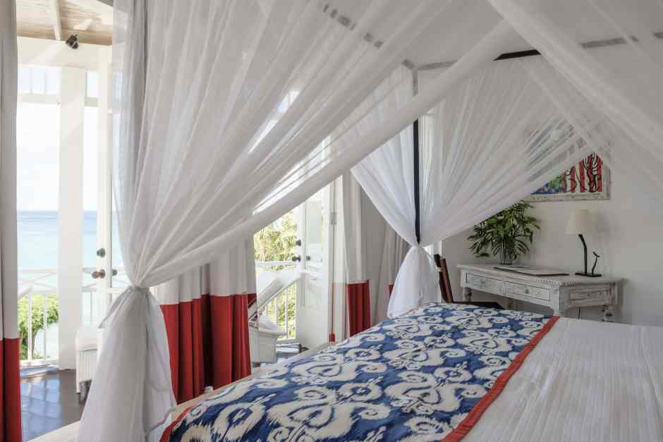 A bedroom at The Cotton House on Mustique, in The Grenadines