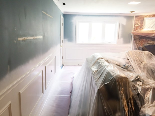 family room with pained wainscoting