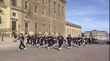 The Swedish Marine band marching next to the Royal Palace