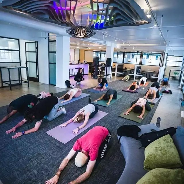 Cafe Om - Our Tenants Engaging in Yoga to Reduce Stress - The Collection
