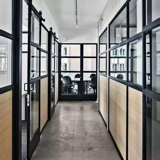 Hallway With 12 Private Offices Available in Our Coworking Shared Office - The Collection