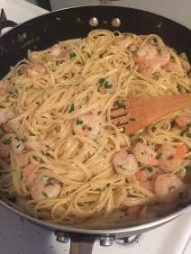 Stir pasta, shrimp and parsley to combine with sauce