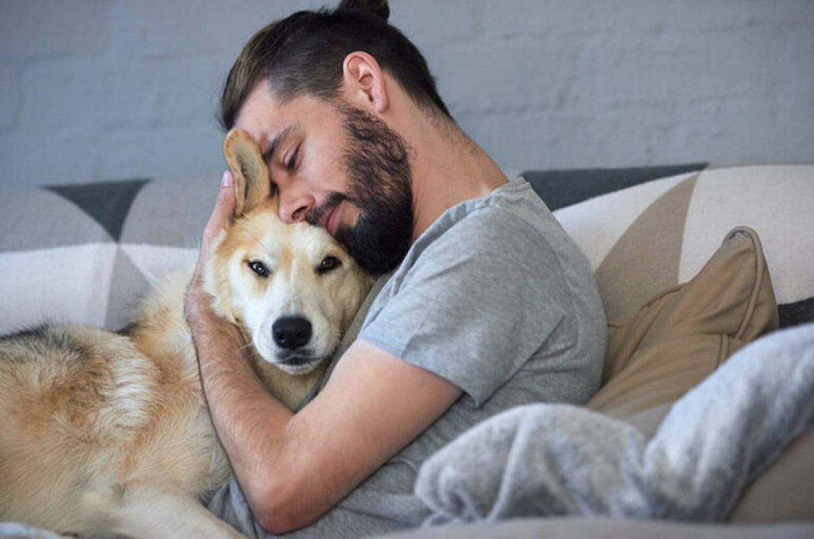 world of dog ownership, man cuddle with puppy