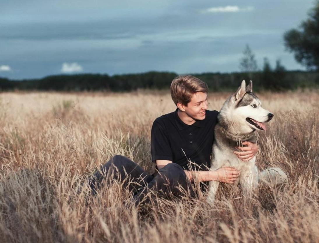 husky dog and happy owner