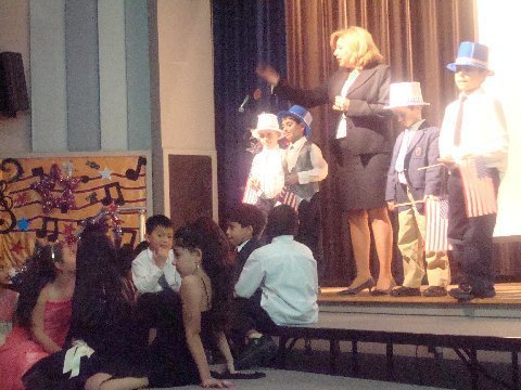 Holliswood School Principal Diane Hobbs congratulating the performers, and encourging the students at our school to be philanthropic and help the nonprofit group Friends of the Coltrane Home with their efforts.
