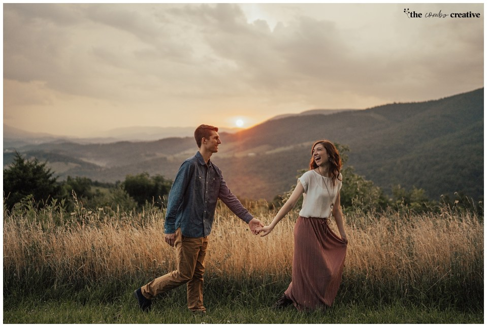 Couple running through the hills of Blacksburg, Virgina while laughing during their engagement session.