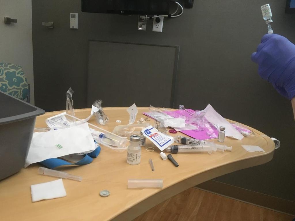 Portable table of pre-medications, vials, and syringes for required for a Remicade infusion