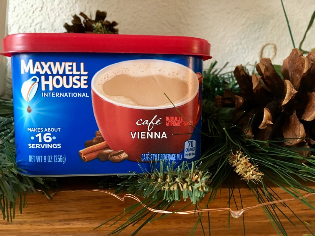 Box of Maxwell House instant coffee on mantle next to Christmas decorations