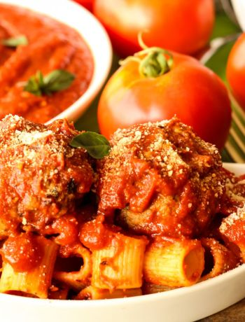 Italian Meatballs are best served over a plate of saucy pasta.