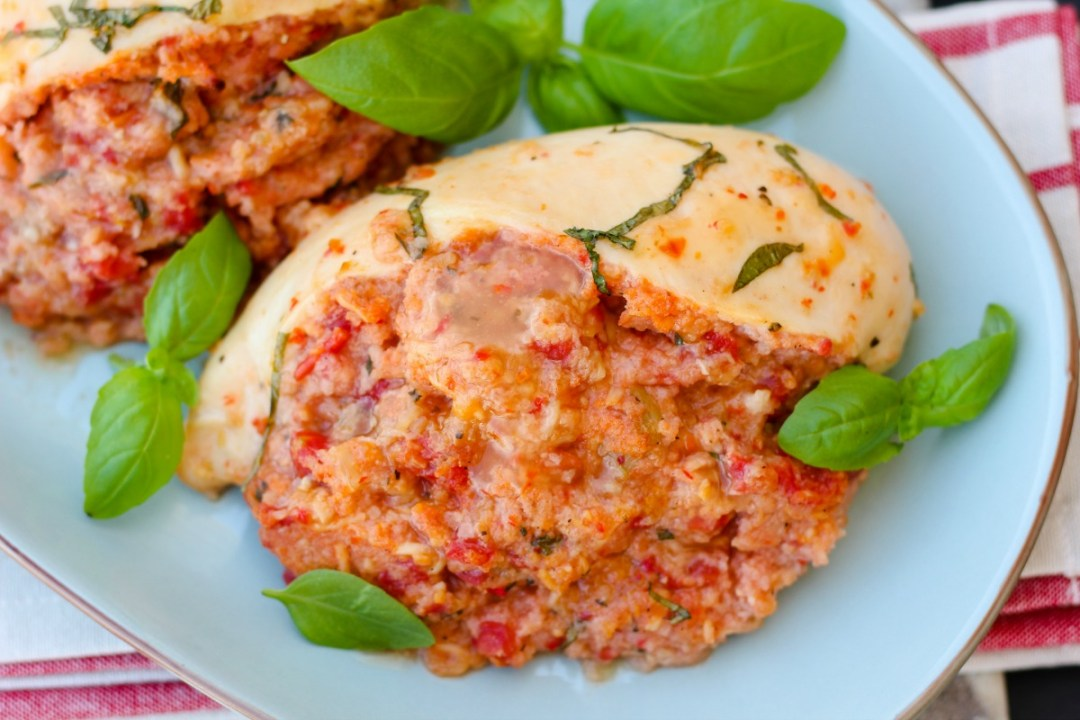Bruschetta Stuffed Chicken ~ Athick chicken breast envelope slit and stuffed with a bruschetta inspired mixture, topped with a zesty dressing and baked.