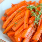 Maple Thyme Roasted Carrots ~ Delicious carrots roasted in real maple syrup and tossed with thyme, salt, and pepper make for the perfect side dish for any meal ~ The Complete Savorist