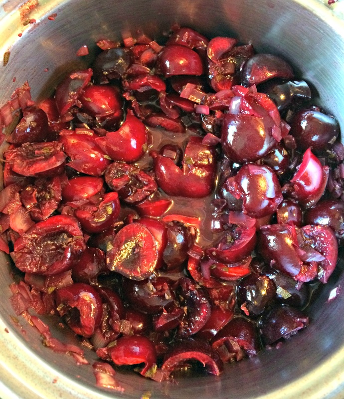 Cherries added to the sauce, now to cook.