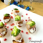 Baguette layered with a bleu cheese pomegranate spread, a succulent slice of pork belly and roasted Brussels sprout chip. ~ The Complete Savorist by Michelle De La Cerda