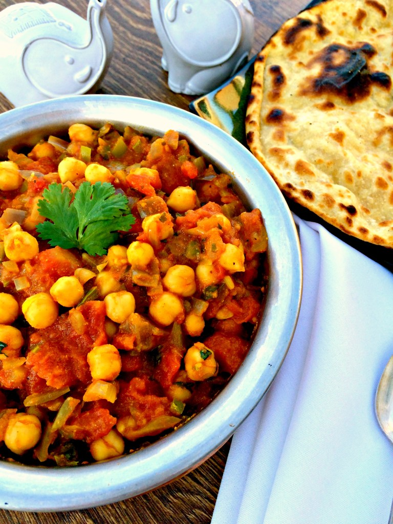 Chana Masala {Chickpeas in a Tomato Sauce} - The humble chickpea in a rich and vibrant tomato sauce seasoned by warm Indian spices ~ The Complete Savorist
