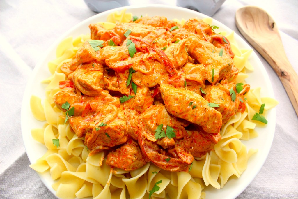 CChicken Paprika - Hungarian Chicken Paprikash is chicken, onions, peppers in a sour cream sauce with a healthy dose of paprika ~ The Complete Savorist