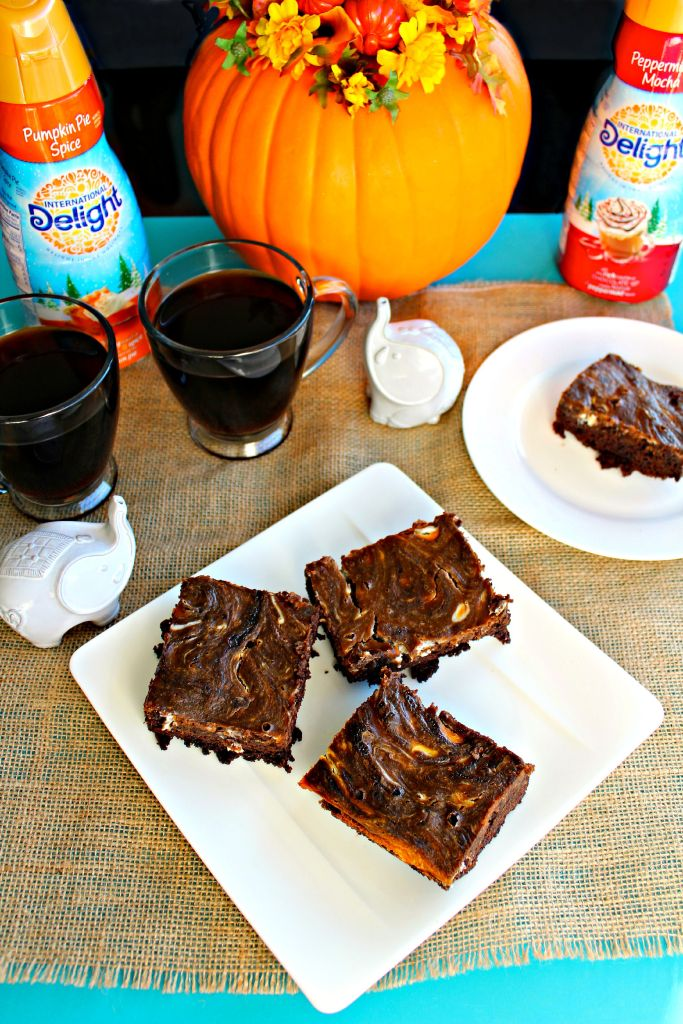 Pumpkin Cream Cheese Brownies - Delicious chocolatey brownies with swirled pumpkin pie filling and cream cheese, both homemade and boxed recipes ~ The Complete Savorist