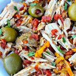 Latin Style Pork Roast ~ Tender Pork Loin Roast slow cooked with warming spices, onions, bell peppers, diced tomatoes, capers, and pimento stuffed green olives ~ The Complete Savorist