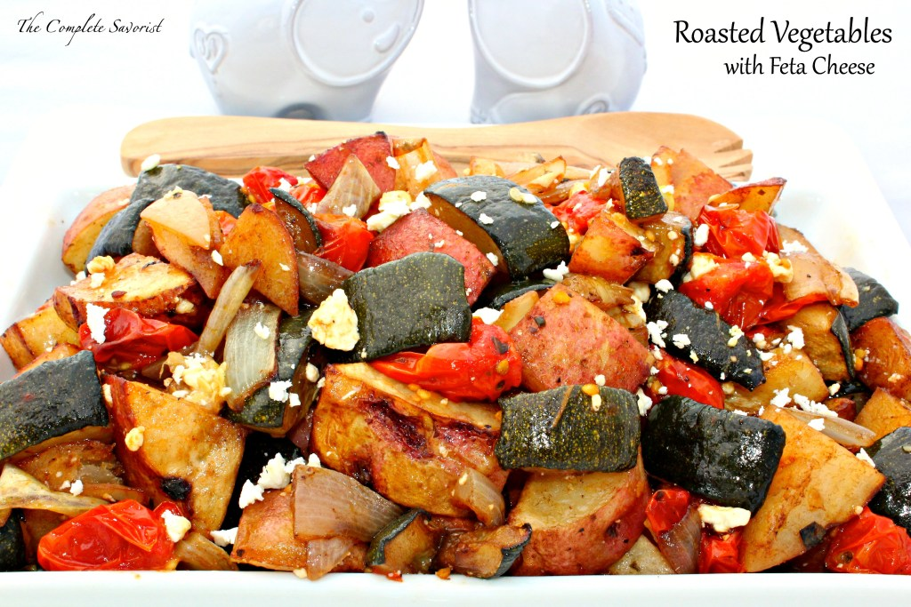 Roasted Vegetables with Feta Cheese ~ Pantry staple veggies of zucchini, onion, potatoes, and cherry tomatoes in a simple vinaigrette and roasted until golden then tossed with crumbles of feta cheese ~ The Complete Savorist