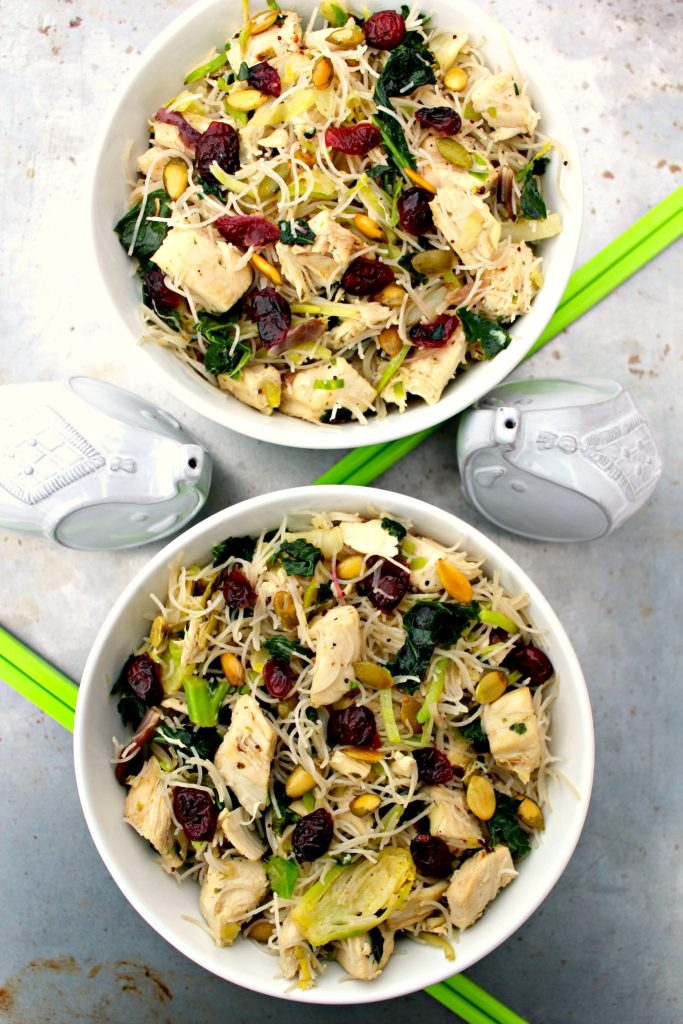 Kale Chicken Noodle Bowls ~ Kale and Brussels sprout salad kit quickly stir-fried with chicken and rice noodles then tossed with the poppyseed dressing, cranberries, and pepitas ~ The Complete Savorist #EatSmartVeggies ad