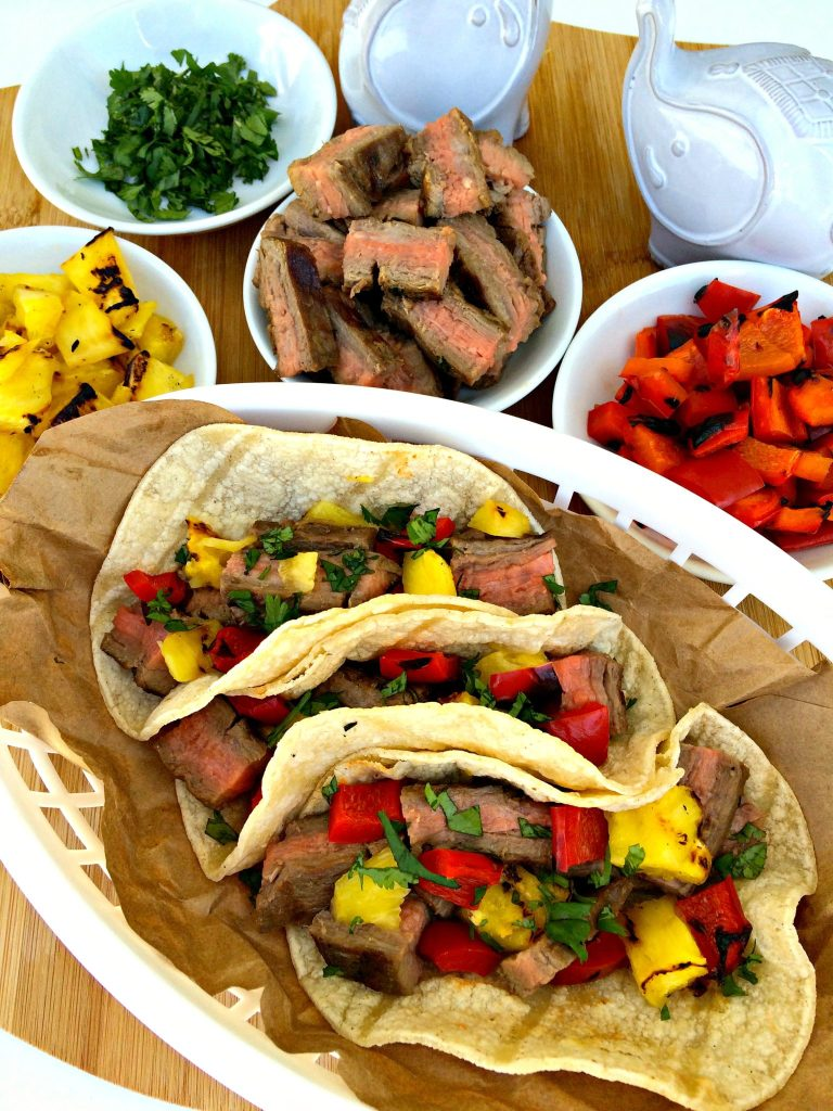 Grilled Steak and Pineapple Tacos ~ Marinated flank steak, then grilled to a perfect medium-rare along with fresh pineapple and red bell peppers, diced together and added to a warmed corn tortilla ~ The Complete Savorist