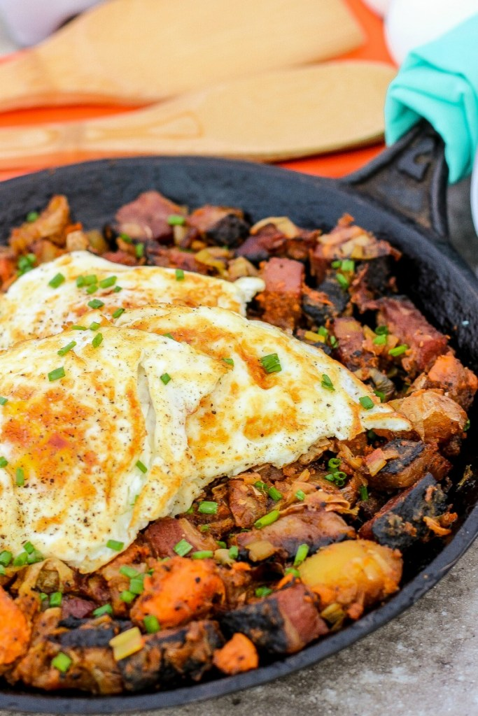Sweet Potato Pastrami Hash ~ Classic hash updated with pastrami, sweet potatoes, and leeks, plus the traditional potatoes and fried eggs ~ The Complete Savorist
