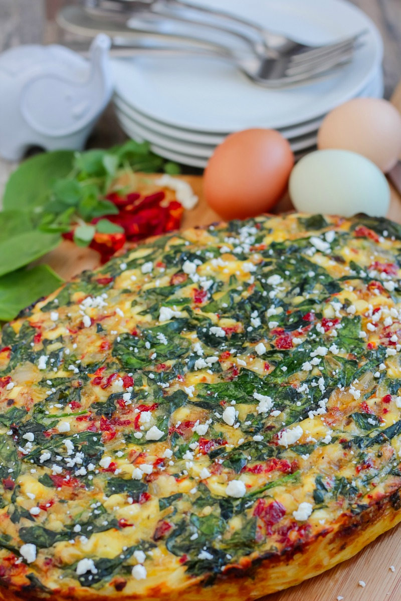Greek Inspired Breakfast Casserole ~ Brunch recipes don't have to be hard. This simple breakfast casserole is elevated with Greek inspired ingredients like feta cheese, spinach, and sun-dried tomatoes ~ The Complete Savorist by Michelle De La Cerda